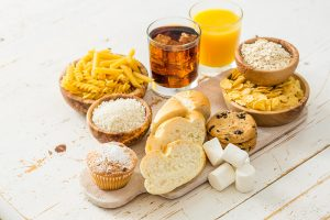 Image of bad carbohydrates, white bread, pasta, sugar