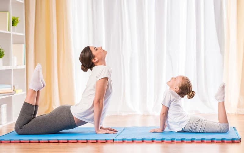 Physical activity, mom doing yoga with daughter, Clancy Medical Group, Vista, CA