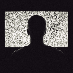 A man watching TV on a close range | common health myths
